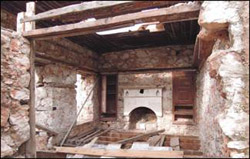 Description: Fig_02_Small Block First Floor Room (during restoration).jpg